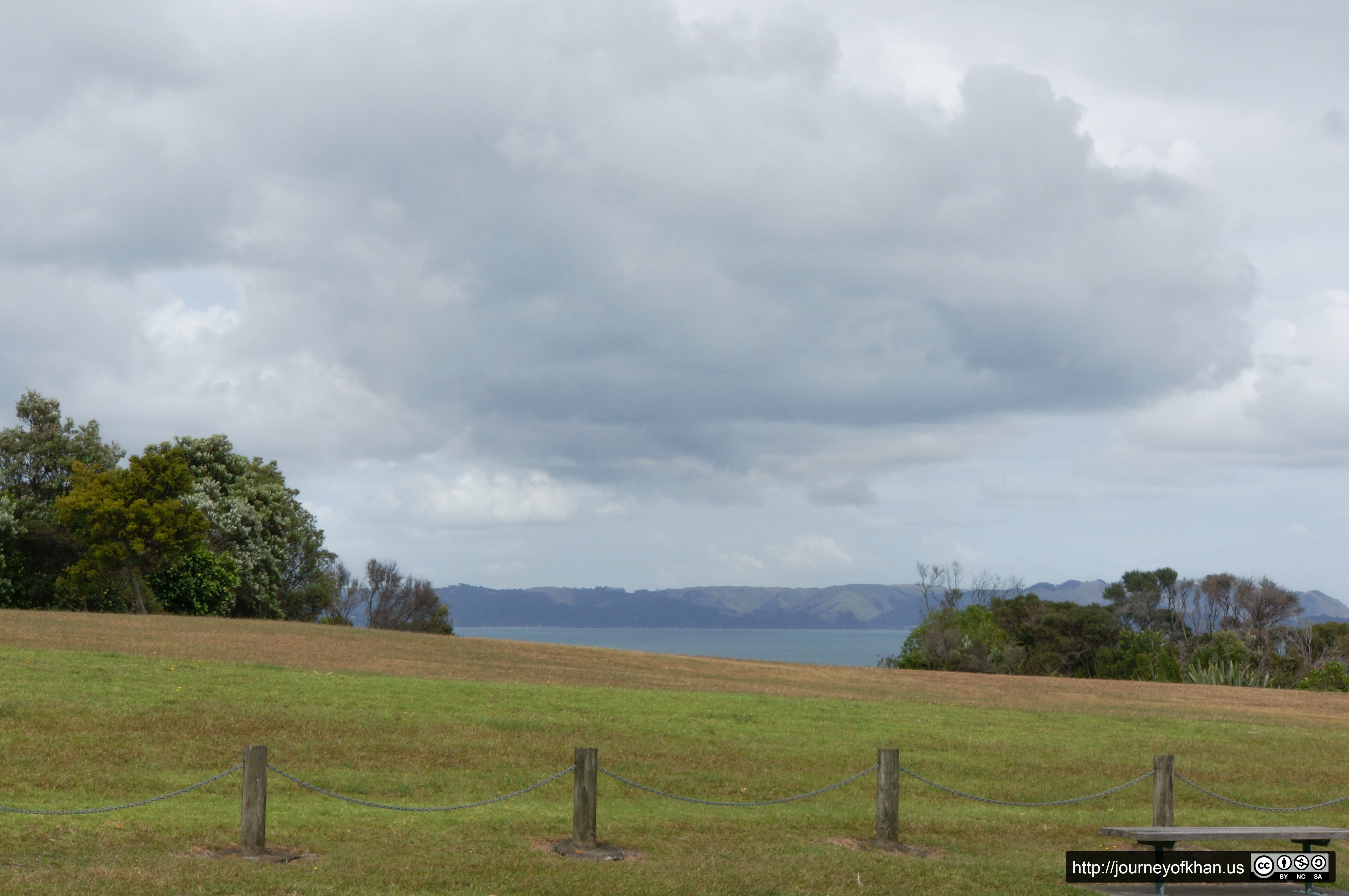 Bench and a Hill near a Bay in Auckland (High Resolution)